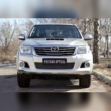 Зимняя заглушка решетки переднего бампера Toyota Hilux 2011-2015