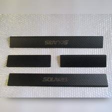 "Накладки на пороги с логотипом модели, серия ""Premium Carbon"""