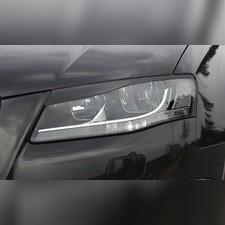 Накладки на передние фары Audi A4 2004-2007