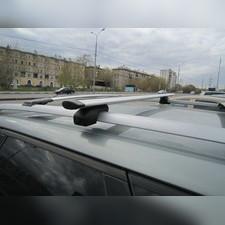 """Багажник на рейлинги крыловидный, """"Евро Крыло с секреткой """", длинна поперечин 130 сантиметров."""