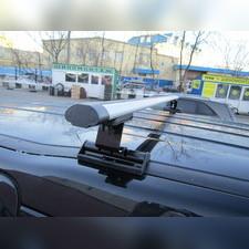 """Багажник на крышу с аэродинамическими поперечинами Opel Astra 2004-2014 """"Аэро"""" (в штатные места)"""